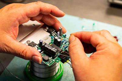 hand assembling a circuit board
